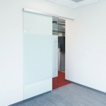 NxtWall sliding frameless glass door with soft open/close door mechanism