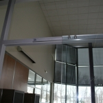 C-rail and roller carriages for sliding glass doors