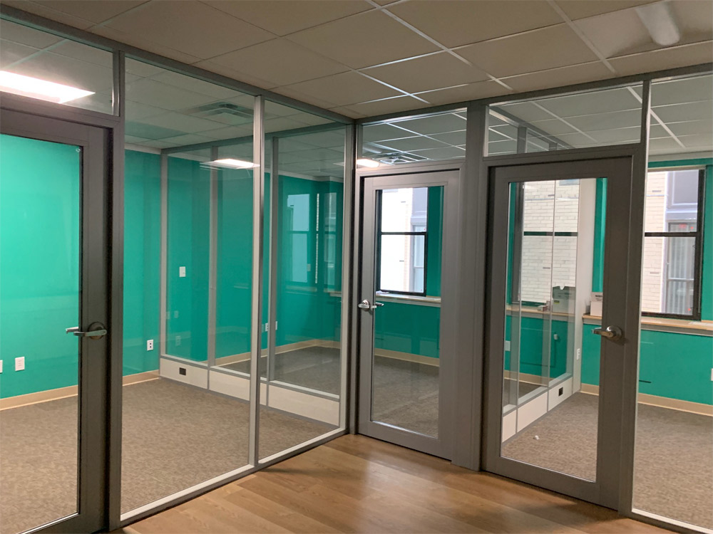 Flex glass fronts with powered kickplate glass side walls