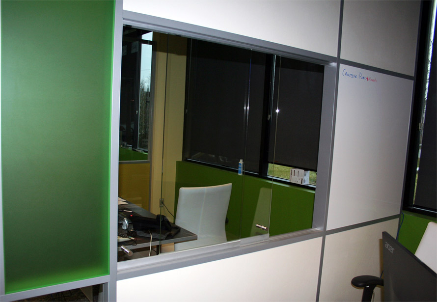Glass sliding teller window at NxtWall Corporate Offices