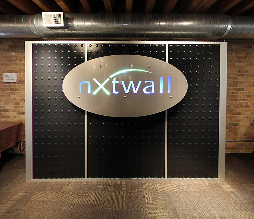 Industrial Laminate Feature Wall with Stainless Steel/LED Backlit Logo