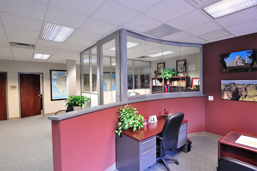 Flex Series wall fronts with View Series curved glass half wall