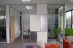 Multi-panel solid and glass Flex series office front