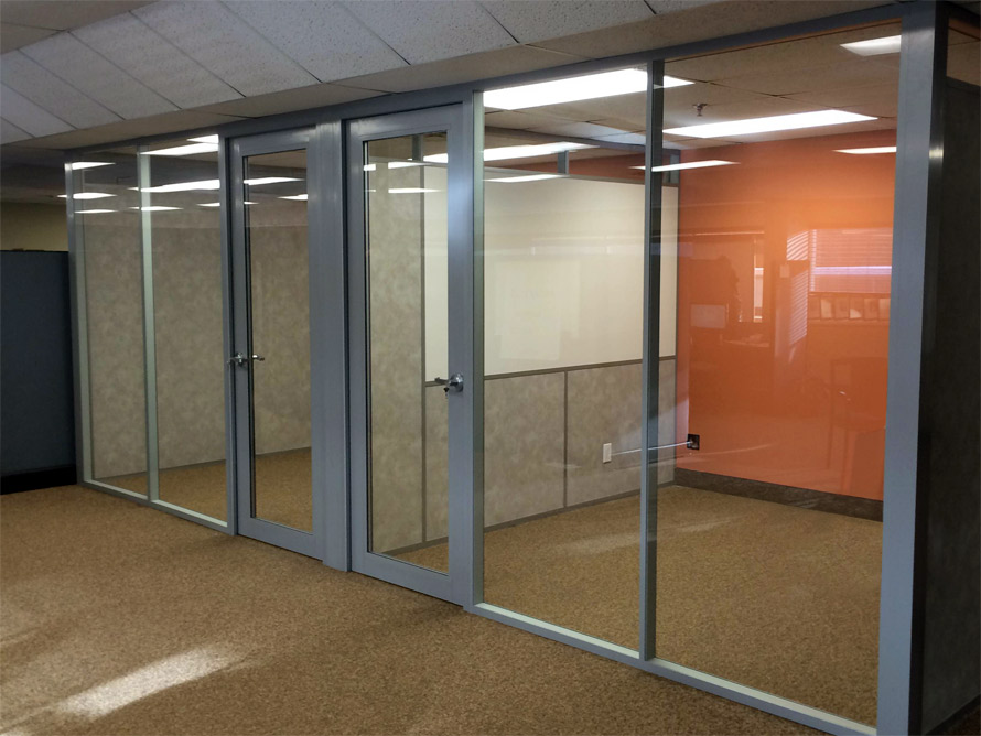 Glass office wall system with integrated whiteboard sidewall