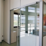 Demountable wall office with locking sliding glass door