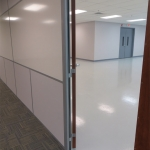 Flex integrated whiteboard wall and swing door hinge profile