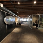Flex Series Feature Wall with Stainless Steel LED Logo - NxtWall Chicago Showroom