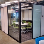 Flex Series freestanding solid office walls integrated with View glass sidelights
