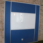 Flex series back painted glass whiteboard with integrated power module and tackable fabric panels