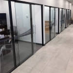 Flex series glass offices and black colormatch extrusions Credit Union installation