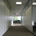 Wrapped gypsum office walls with clerestory