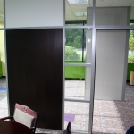 Flex series with segmented glass clerestory and solid wall panels