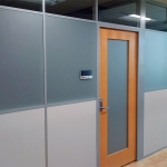 Wood framed swing doors with frosted glass inserts - Flex Series