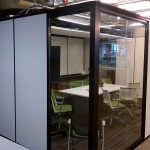 Freestanding Flex Series solid walls / View Series glass sidelights integrated office with black extrusions
