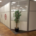 Freestanding solid office walls with glass clerestory