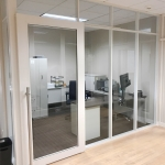 Glass offices NxtWall Flex Series - Warm White Aluminum Frame Finish