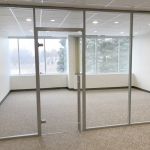 Glass swing door Flex Series with barpull hardware