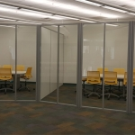 Higher Education freestanding curved glass wall installation - NxtWall