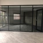 Glass wall with multiple transoms and black aluminum frame finish