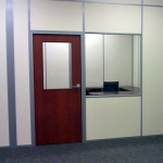Solid Office Walls with Sliding Glass Teller Window