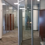 Angled interior glass wall private offices flex series