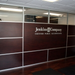 Anodized wall frames with laminate wall panels
