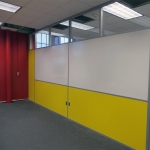 Classroom dividing wall partition with built-in whiteboard and clerestory
