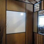Integrated whiteboard wall with black wall trim and glazing bead