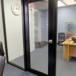 Custom black door with black glazing bead - Flex series movable walls