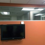 Cut-in window integrated with standard drywall construction