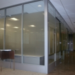 Demountable glass walls with power raceway