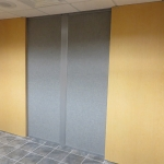 Double wood sliding doors with pleats grid silverado finish wall panels
