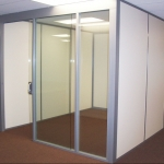 Flex Series - Glass Office Front with Sliding Glass Door and Solid Side Panels