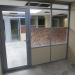 Offices with aluminum framed glass insert swing doors