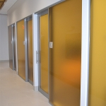 Flex series offices with custom film glazing