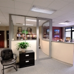 Private office with View series curved glass demising wall