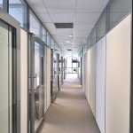 Flex Series private offices with sliding glass aluminum framed doors