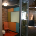 Freestanding breakout room with fabric acoustical wall and ceiling panels