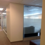 Glass office wall with square pattern frosted film