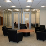 Glass offices with aluminum framed doors