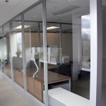 Glass offices with modular power raceway