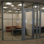 Glass wall systems with radius aluminum corners