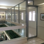 Glass wall with sliding door
