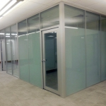 Frosted glass offices with aluminum framed glass doors and clear tempered clerestory