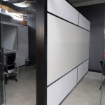 Freestanding offices with black extrusions and whiteboard demising wall