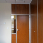 Office with solid wood panels matching door and glass sidelight