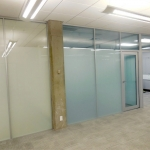 Privacy glass frosted full height wall system in University classroom application