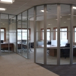 Segmented glass curved office walls
