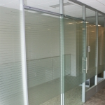 Office with privacy window film and sliding glass door
