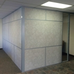 Solid vinyl-wrapped gypsum wall panel office with glass sidelight